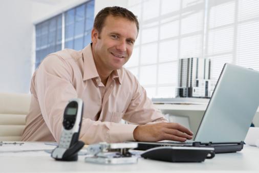 man-smiling-computer